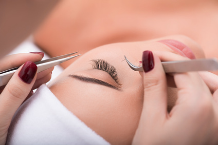 My favorite procedure. Close up of eyelash extension procedure in beauty salon for attractive woman